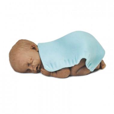 Ciemnoskóre niemowlę pod kocykiem z marcepanu, niebieski